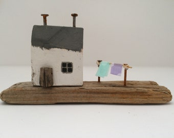 Tiny rustic wooden seaside cottage scene