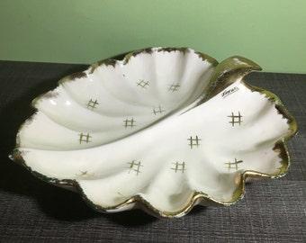 Old slip leaf-shaped dish signed