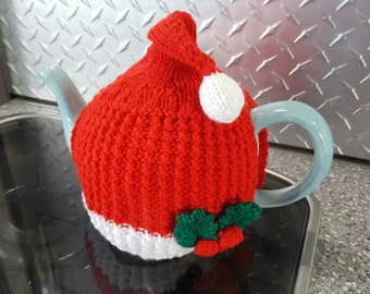 Cute Christmas Santa Hat Teapot Cosy that fits a variety of different sized Teapots due to the stretch ability.