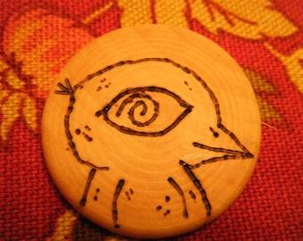 Dizzy Bird pyrograph pendant