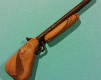 Polymer clay shot gun charm