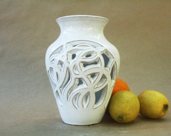 White vase carved by hand.