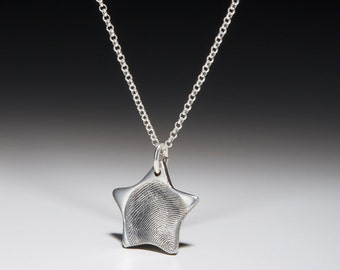 Silver chain with fingerprint star pendant