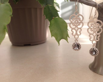 Earrings with lace silver and grey swarovski stones.