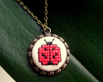Ladybird necklace. Hand embroidered jewelry.