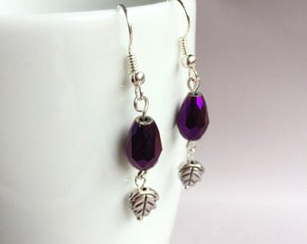 Purple iridescent faceted glass bead with leaf charm earrings