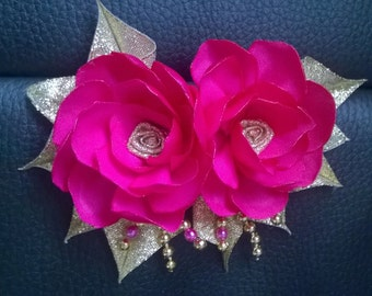 Hot pink flower fascinator on hair comb