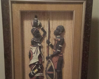 African wall art, wood art of African man and woman
