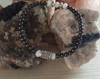 Beautiful hematite with white glass rondel accents.