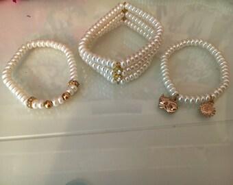 Charm Bracelets in Gold