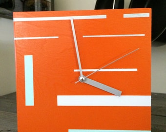 Designer Clock:  Orange with Silver, White and Blue