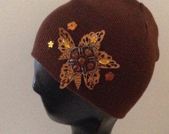 In time for fall.  Brown beanie bedazzled with leaf & rhinestones