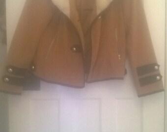 Beige-orange long sleeved coat with faux fur.