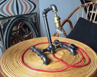 Industrial lamp made with black cast-iron fittings