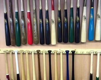A fully customized MAPLE wood bat including length, colors, personalization, and model - Game ready bat customized exactly how you want it.