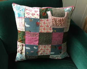 Memory cushion made from beloved baby dresses and clothes