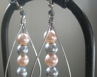 Faux pearl blush and gray tear drop earrings are drops of simplicity.
