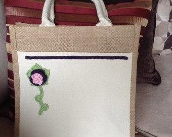 jute bag with hand-crocheted flower accent