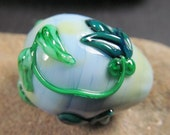 Baby blue Easter egg lampwork bead focal with raised teal blooms.
