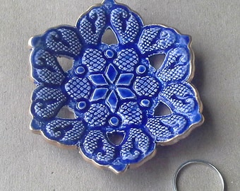 Ceramic Carved lace Ring Bowl blue edged in gold