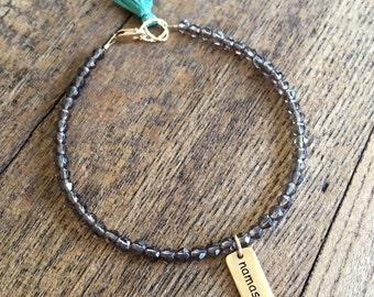 Namaste and smoky quartz dainty charm bracelet. Yoga gemstone stacking bracelet.