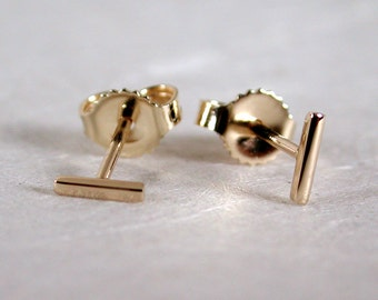 5mm x 1mm Solid 14k Gold Earrings Tiny Little Bar Studs Gold Skinny Thin 14k Yellow Gold Staple Studs by SARANTOS