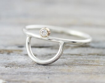 Half moon engagement ring in sterling silver and gold with tiny diamond