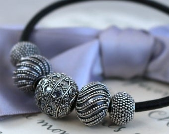 Black Leather Cord Bracelet with 5 Sterling Silver graduated Bali beads