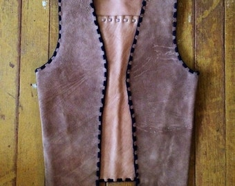 Vintage 70's handmade tan colored leather vest. Size Small