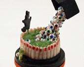 12thscale handmade miniature eyeball anti gravity cake
