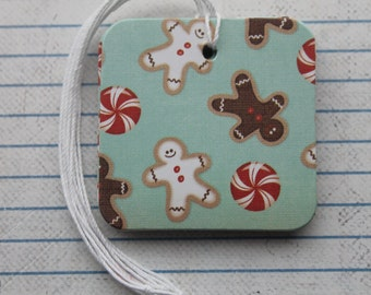 25 Christmas tags gingerbread men/peppermints chipboard covered tags.. 2 x 2 inches
