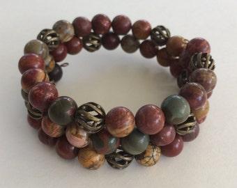 Picasso Jasper bead bracelet memory wire -  bronze accent beads