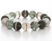 grey glass bracelet with sterling silver, stretch style, artisan lampwork jewelry