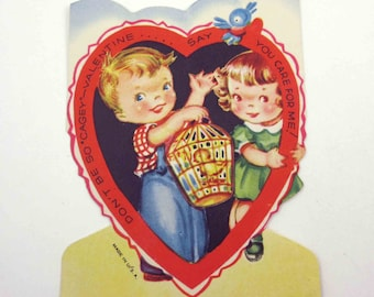 Vintage Children's Novelty Valentine Greeting Card with Cute Boy and Girl and Bird in Bird Cage