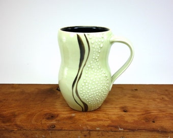Pale sage green glazed curvy porcelain (tall) mug with slip trailed dots (#2)