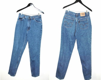 80s vintage LEVIS mom jeans high waisted classic dark wash tapered skinny levis jeans size 30