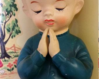 Praying for peace figurine