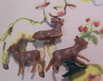 three wee tiny plastic deer