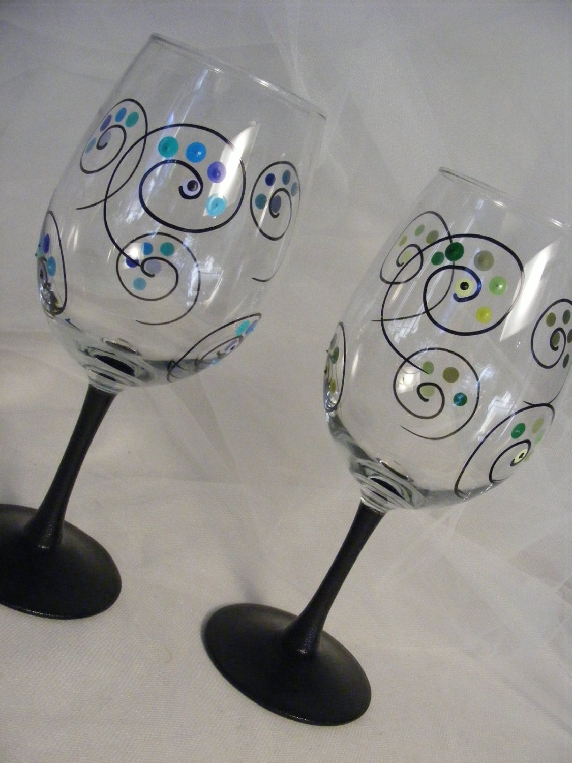 Painted Wine Glasses With Polka Dots And Swirls And Black Stem