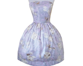 Size small Last one Shimmery roses dress in purples and cream last one.