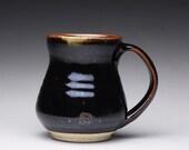 handmade ceramic mug, pottery teacup, coffee cup with black tenmoku and satin white glazes