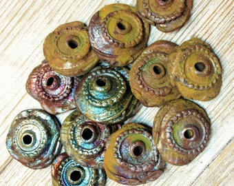 86b. Wondrousstrange Raku Eye of Newt, Toe of Frog Twelve Raku Beads Mustard Yellow Blue Green Copper
