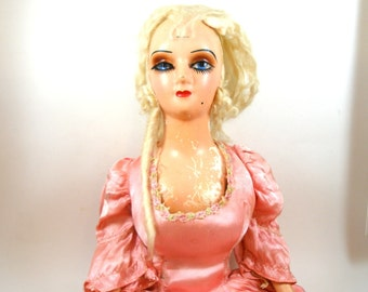 1920s French boudoir doll in pink satin dress, shabby chic fun.
