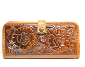 Beautiful 1960s tooled leather wallet . Super shiny embossing . Perfect billfold for VLV . Rockabilly lifestyle 1950s