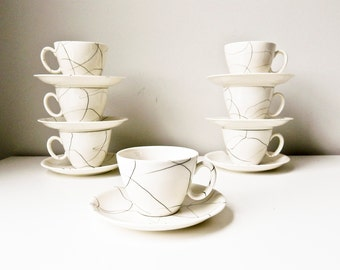 Mid Century Cups and Saucers Set of 7 White with Black Dribbles Carrara Modern China by Iroquois
