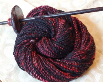 Red Eyes, Black Skies handspun two ply merino and bamboo yarn, 110 yards of worsted weight.