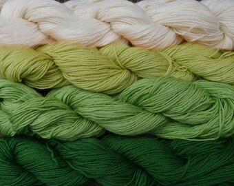 Pure wool yarn Fingering weight,   off white, lime, apple and green , 4 skeins, 7 oz.