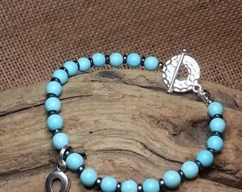 Magnesite and Hematite , Gemstone healing bracelet, hand beaded ,  47