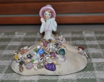 Antique Pincushion Half Doll with Bonnet on Sand Dollar Shell