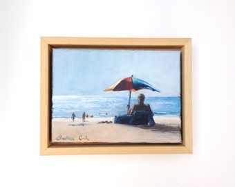 framed oil painting: watching the sunset shimmer on the sea at the beach with parasol